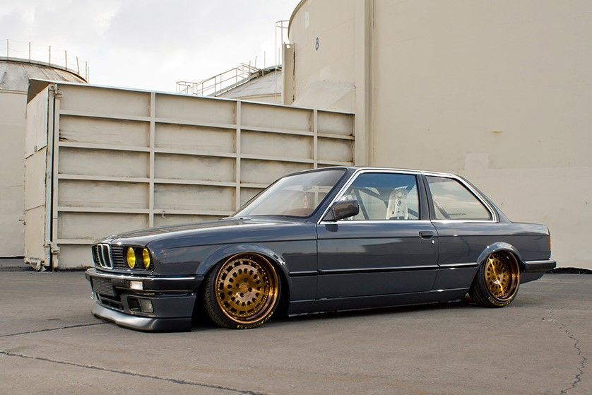 grey-colored BMW E30 stance